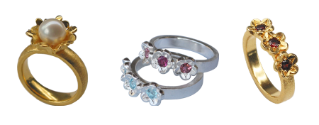 florelli ring in silver gold plated with sweet water pearl, 2 silver rings with pink tourmaline and blue topaz and 1 ring in silver gold plated with garnet